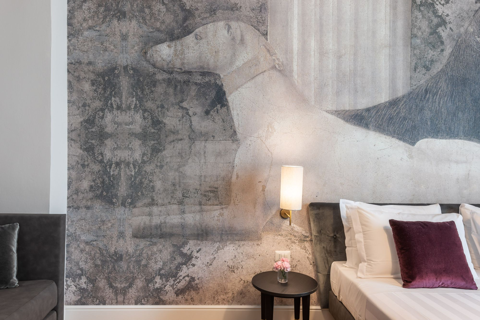 A detail of the deluxe room decorated with Piero della Francesca's  greyhounds
